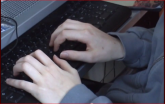 A boy's hands on the keyboard